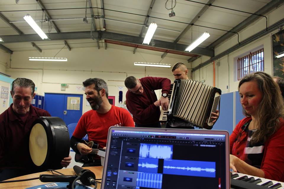 Inmates play music during a recording session