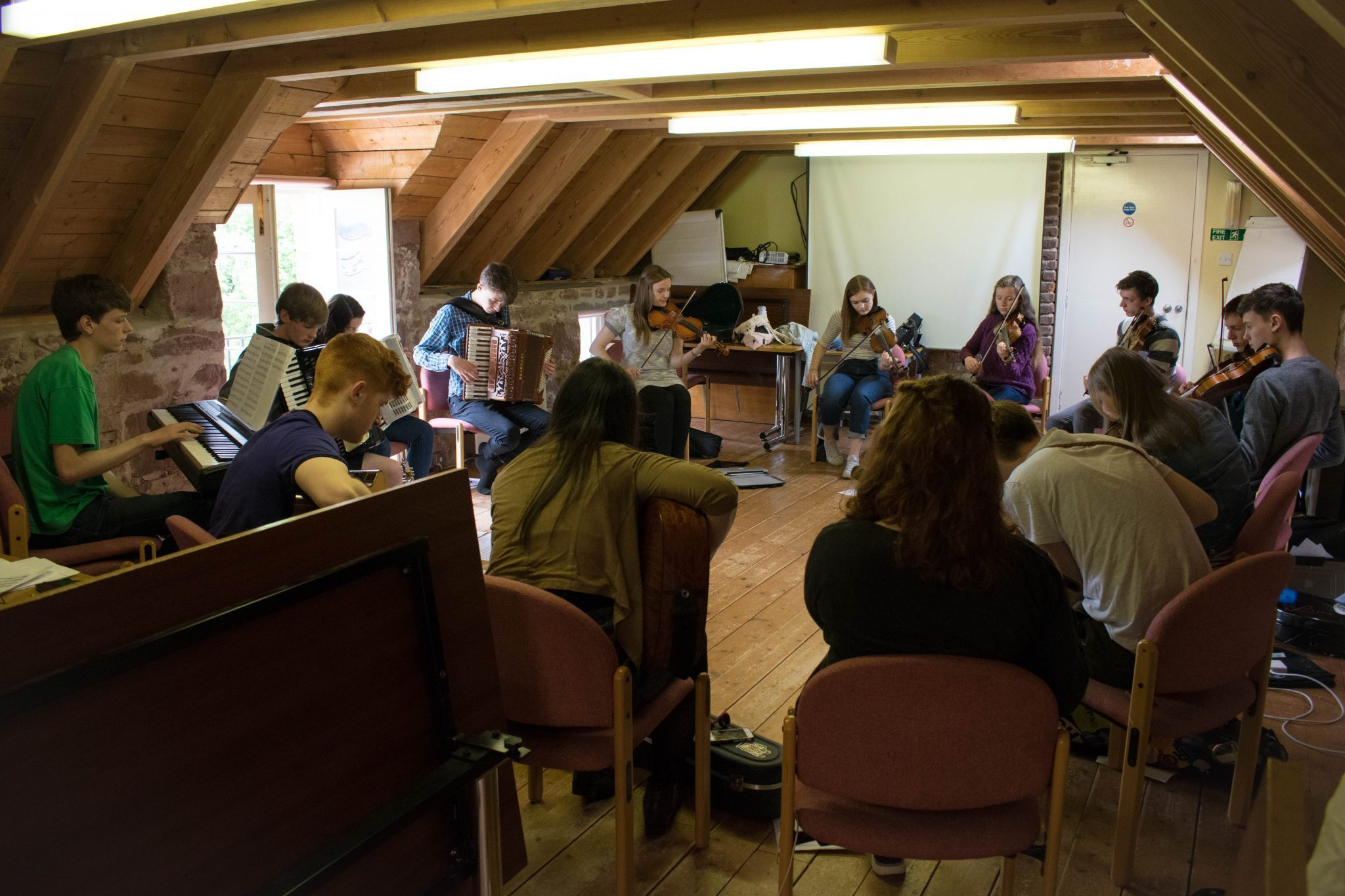 Ceilidh Trail musicians rehearse with fiddler Lauren MacColl in Cromarty.