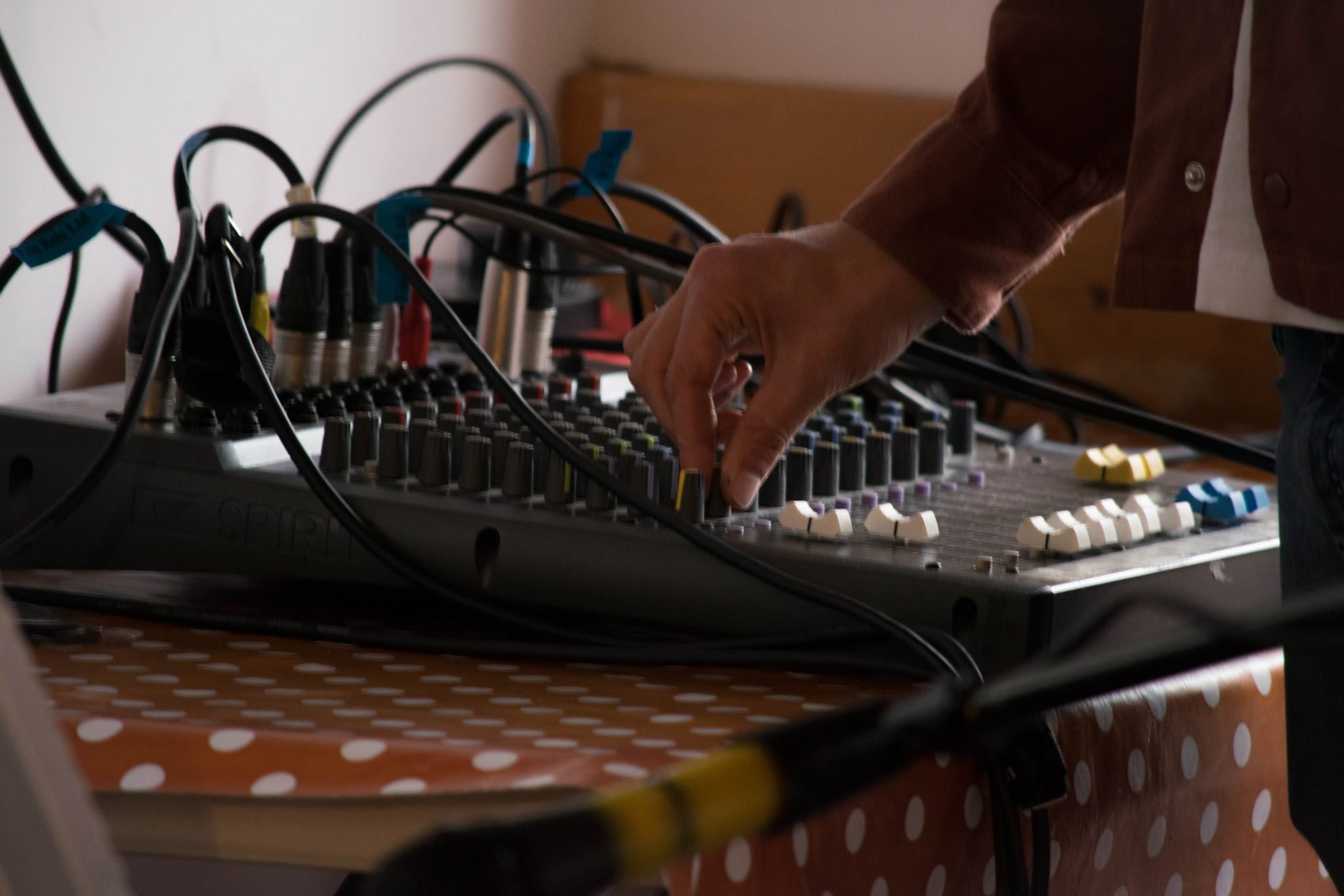 A mixing desk is being shown in a demonstration of live sound