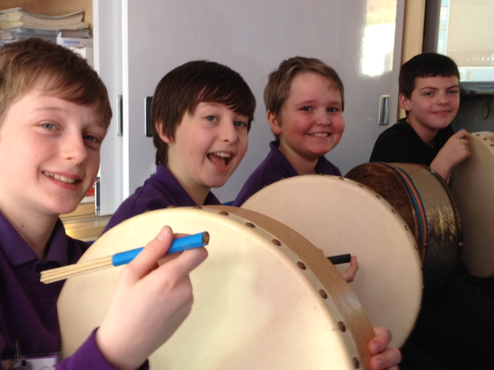 Bodhran players pose for the camera.