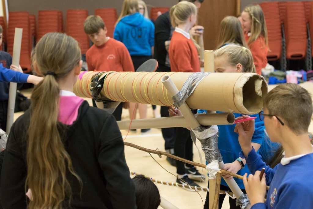 Pupils create their own musical instruments.